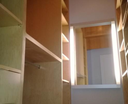 custom walk in closet - many shelves
